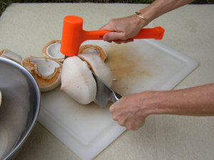 split your coconut with the knife and mallet